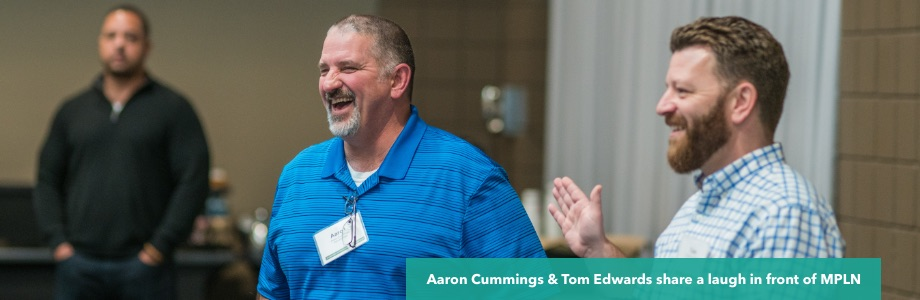 Two principals laughing during professional learning